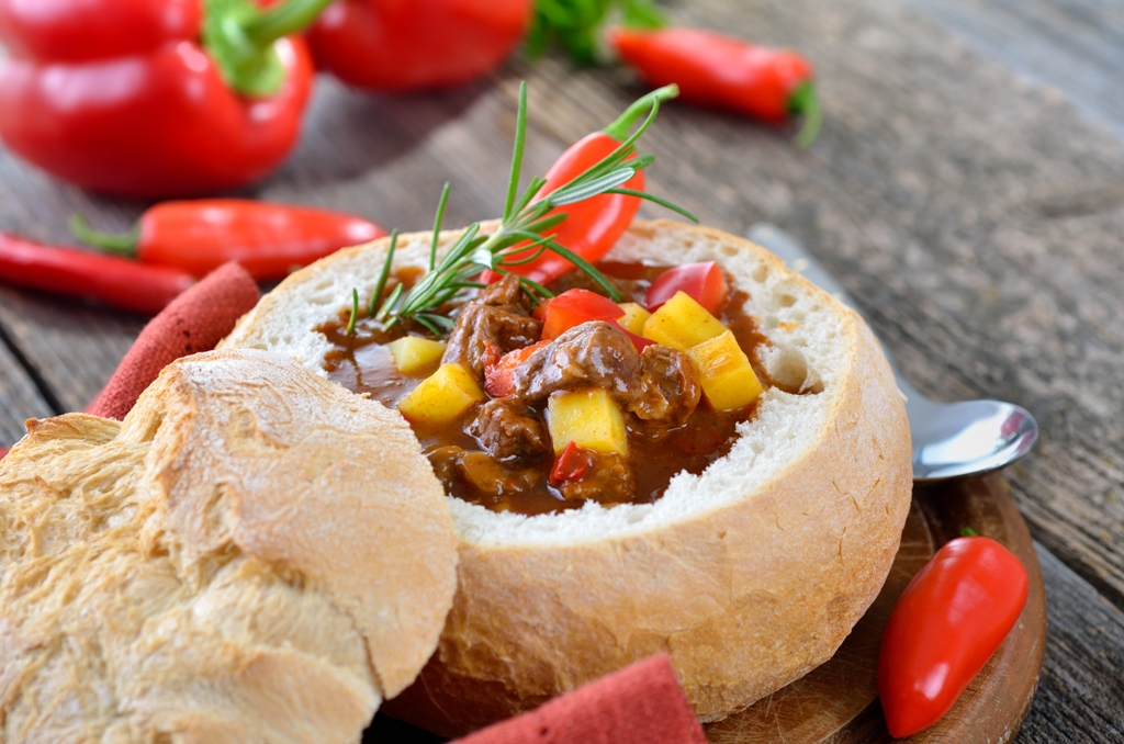 Hungarian Gulyás soup in bread bowl